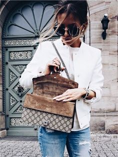 Gucci handbag, white t-shirt and distressed denim jeans