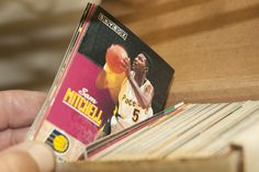 SPORTS MEMORABILIA INCLUDES BASEBALL AND BASKETBALL CARDS BY TOPPS AND UPPERDECK, PLUS LIMITED EDITION MICHAEL JORDAN LOCKER SERIES. MOST OF THE CARDS ARE FROM THE 90S.