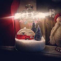 It's a cookie jar, Epson salt, mini trees, camper ornament from World Market, string and Washi tape for the bunting... and LED strand lights.