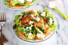 Crispy Buffalo Quinoa Bites Salad - Quinoa bites with a buffalo-wing-flavored sauce top this gorgeous salad, which is finished with a Greek yogurt-buttermilk dressing. Oh, my!
