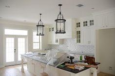 Love The Quatrefoil Backsplash, White Cabinets And Glass Pendant Lights!  Wood Floor Kitchen,