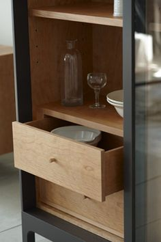 The Joyce cabinet has sliding glass-fronted doors and a timber-lined interior with four adjustable shelves and four drawers. There are 2 cable grommets above the drawers. Built In Furniture, Modern Furniture, Furniture Design, Kitchen Sideboard, Sideboard Cabinet, Japan Design, Glass Wardrobe, Muebles Living, Interior Photography
