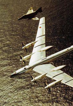 An American F4 Phantom shadows a Soviet Tu-95 nuclear bomber as it approaches US airspace