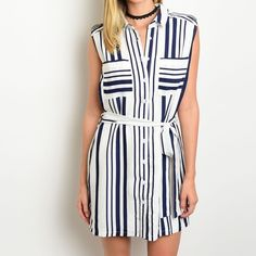 ✨NEW✨White Navy Stripe Tank Shirtdress Sleeveless dress with vertical navy stripe and contrasting print pockets. Tie waist, button front and collared. Available in S M L. Dresses