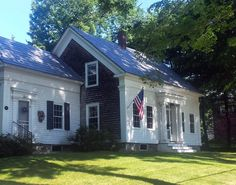The steep roof, story-and-a-half construction and center chimney identify this as a Cape Cod style house. The Greek Revival detailing is iconically Maine. This is also on Pascal Avenue in Rockport.