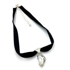 """Ice Ice Baby is a Clear Swarovski Crystal Suspended on a Sterling Silver Pendant Holder on a 14 ½"""" Black Velvet Choker with Sterling Silver Ends and a Lobster Clasp with a 3 ½"""" Sterling Chain Extender. Product #16-098"""