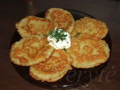 Lithuanian potato pancakes are called Bulvinai Blynai or Zamaiticki Blynai. They are made by grating potatoes and mixing with flour and egg. This mixture is then molded into pancakes and shallow fried in oil. They are served with sour cream and bacon bits.