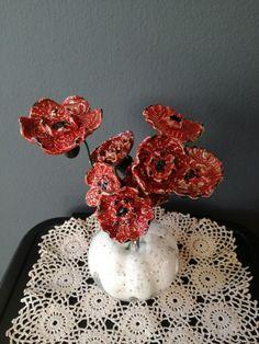 Bloemen keramiek eigen werk.