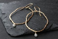 Organic Raw Diamond Hoop Earrings by LexLuxe on Etsy simple, earthy and chic.  hand-forged 14kt gold filled organic hoop earrings with raw silver diamond briolettes