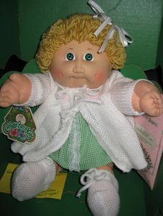 Cabbage Patch Kid Girl In Box(this looks like my first one I ever got, but mine had a blue dress with a duck on it) Carrie was her name