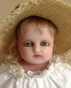 Stunning English poured wax doll.