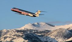 (HighSierraSpotters.com)   The shadows and the golden glow of the scene easily reveal the time of day.  Just a few moments after sunrise, this MD-83 climbs away past Mt. Rose (just south of Reno Tahoe International) at the start of an early morning flight to KDFW.