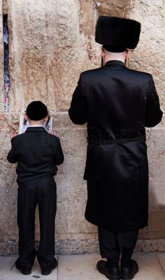 prayers by the western wall, jerusalem