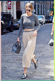 Gigi Hadid upped the ante when she stepped out in these paper-bag-waist beauties, complete with preppy turn-ups. Match with a tight, ribbed crop top and seal the chic deal with pointed metallic brogues and a steel-grey tote bag