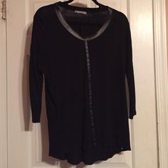 Zara 3/4 sleeve top with leather detail Zara 3/4 sleeve top with leather detail. Leather trim goes around the neck and down the center of the shirt. Worn a few times in great condition. Zara Tops