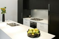 Contemporary #kitchen to fit within a #modern family lifestyle- black and white colour combination http://rccoppinltd.co.uk/kitchens-worktops/