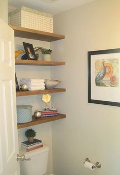 s 23 insanely clever ways to eliminate clutter, organizing, storage ideas, Put Shelves Above Your Toilet