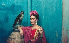 Frida Kahlo and her pet eagle