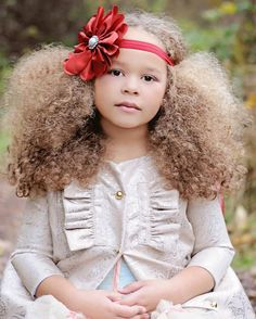 That's a beautiful headband and it goes perfectly with her big, beautiful, natural hair.  ♥
