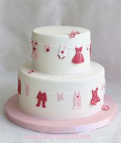 "Depending on gender, the ""clothes"" could be in shades of pink/lilac (girl) or blue and a complementary color for a boy. I'd also put something atop the cake - it looks a bit bare."