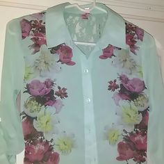 Mint green sheer blouse Sheer fabric..floral print front..lace back on upper half..sheer flyaway bottom..hi lo hem. Sleeves can be worn up or down Dolled up by Fang Tops Blouses