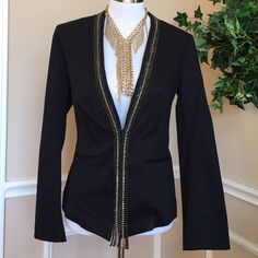 Rock & Republic rhinestone blazer, size 8 Beautiful, black blazer is super versatile for many occasions. Can be paired with anything from jeans to dresses. Blazer closes with a hook closure. The rhinestone in colors of black and clear cascades loosely from the closure to the bottom of the garment. Unlined. Excellent condition. True to  size. Rock & Republic Jackets & Coats Blazers