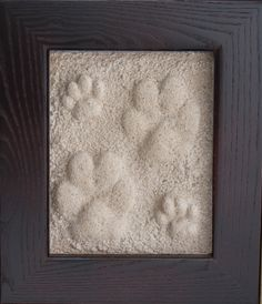 Footprints in the sand! This great website has impression kits to forever treasure your doggies paw prints!