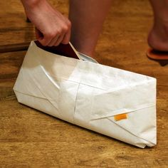 Origami Clutch: Made of Tyvek which looks like paper but is as durable as fabric. Inside zipper. $29.95.