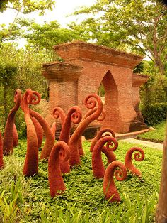 Fern sculptures in gardens of American's home near Chiang Mai in Thailand.
