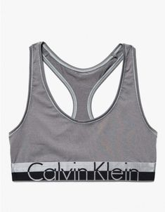 A soft stretch jersey bralette from Calvin Klein Underwear.  Features scoop neckline, sporty racerback, thick elastic band, front logo on dual-toned underbust band and stretch fit.  •Soft stretch jersey bralette •Scoop neckline •Sporty racerback •