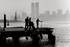 Fishermen with a view on the twin towers of the World Trade Center and the Statue of Liberty National Monument, on the Caven Point Pier off of Port Liberte in Jersey City, N.J. in 1993. Photo by Keith Meyers/The New York Times