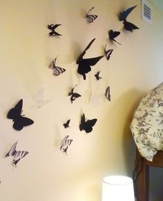 DIY butterfly wall decor. Did this!! But with black scrapbook paper... printed pics (template) of butterflies, cut them out, traced onto scrapbook paper and cut that out. Then I just used tape to stick to wall!!!! This is awesome and looks amazing in my room!! Very easy too and just used what I had on hand :)