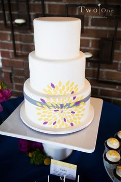 Modern grey and yellow wedding cake - navy where the purple is