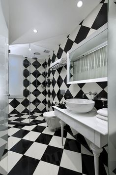 Are we g a wrought for black and white Art Deco tiles on floors and walls? I'd we went for plain glass shower rather than the glass blocks we were thinking about...hmmm. And I really like the simple vanity but would like to to be a mix of black and white, eg black basin! But that would work in a plainer bathroom, not this one!
