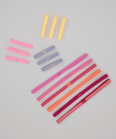 Take a look at this Pink & Iron Hair Tie & Headband Set - Unisex by Nike on #zulily today!