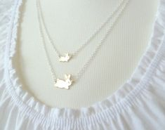 Bunny rabbit necklace - sweet mom and little baby brass bunnies on double layered silver chain, mixed metals  - Hare Family via Etsy