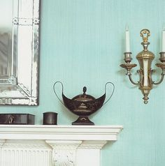 Pretty sky blue living room: Glazed walls + painted mantle + silver accents uploaded by xJavierx, via Flickr