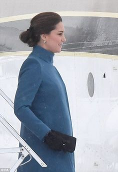 The Duchess wore her brunette locks in a simple chignon and accessorised with a pair of black bow gloves believed to be from Cornelia James London
