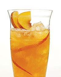 Peach Donkey: 1 ounce vodka 1/2 ounce ginger liqueur 3 ounces peach puree or nectar Crushed ice 1 ounce chilled ginger beer Peach slices, for garnish (opt...