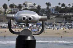 Commerical Telescope offering a view of Santa Monica Beach, California Royalty Free Stock Image