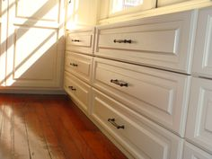 A close up look at the traditional style pull-out drawers of this custom wooden built-in dresser. Built by Woods Cabinets, LLC. Built In Dresser, Custom Shelving, Shelving Units, Pull Out Drawers, Entertainment Centers, Wood Cabinets, Built Ins, Bookshelves, Woods