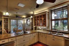 See this Craftsman-style eat-in kitchen with beautiful cream cabinets and earth tones at HGTV.