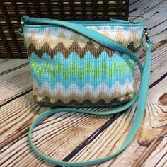 LIZ CLAIBORNE CHEVRON PRINT CROCHET CROSSBODY BAG This is so pretty in great spring and summer colors and a trendy Chevron print. Super clean inside and out. 1 outside snap pocket and 2 inside Liz Claiborne Bags Crossbody Bags