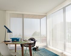 Wonderful alternative to Vertical Blinds on Sliding doors, patio doors, and large windows.   Luminette® Privacy Sheers with PowerView™ Motorization
