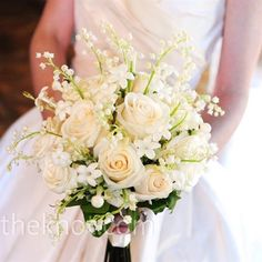 White Wedding Bouquet Ivory roses, stephanotis, and lilies of the valley combined for a soft bouquet with a classic feel.