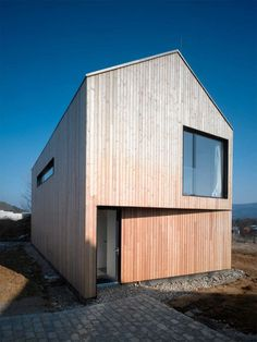 simple but effective overhang for door. back of house has it for balcony. house in lety by studio pha