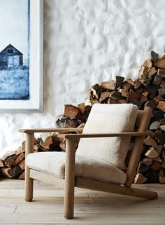 The simple raw beauty of Ralph Lauren Home's rustic armchair is complemented by cozy shearling upholstery.