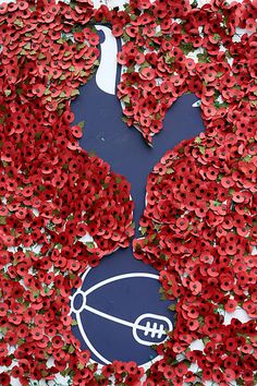 Poppies are stuck to the Tottenham Hotspur badge outside the stadium prior to kick off during the Premier League match between Tottenham Hotspur and Leicester City at White Hart Lane on October Get premium, high resolution news photos at Getty Images Tottenham Hotspur Wallpaper, Tottenham Hotspur Fc, London Pride, Spurs Fans, White Hart Lane, Fc Chelsea, European Soccer, Zinedine Zidane, English Premier League