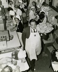 Actor, Laird Cregar carries a tray of sandwiches for the servicemen at the Hollywood Canteen