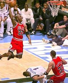 Michael performs his version of the high-jump, as Penny Hardaway gets out of his way.